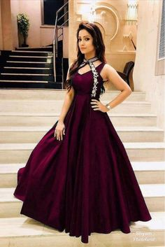Wine Color: Wine Fabric : Taffeta Satin Thread Work Stitch Type : Full StitchedNeck Type: RoundSize : Free size fits to all Length : 58 Inch Designer Anarkali Dresses, Designer Silk Sarees, Designer Gowns, Designer Wear, Designer Kurtis, Indian Gowns Dresses, Red Gowns, Simple Gown Design, Simple Gowns