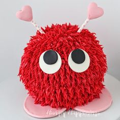Guess what's hiding inside this Warm Fuzzy Piñata Cake.