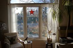 A window full of Origami stars.   I used the tutorial pinned in my Swedish Christmas board.