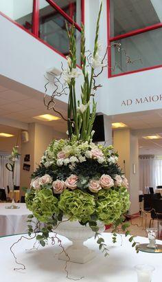 Urn Flower Arrangement, using Sweet Avalanche roses, Hydrangea, Eryngium, Antirrhinum,Carnations, Gladioli, Freesia's, Eucalyptus cinerea and Witch Hazel.