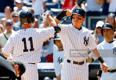 Brett Gardner #11 of the New York Yankees celebrates his first inning two-run home run against the Cleveland Indians with teammate Jacoby Ellsbury #22 at Yankee Stadium on August 22, 2015 in the Bronx borough of New York City.