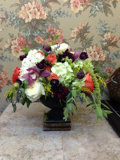 Mixed flowers in black garden urn