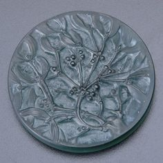 Rare invitation medallion for Rene Lalique`s first all-glass exposition, Paris 1912, green with whitish patina.