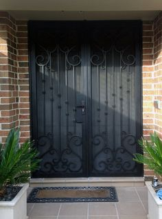 View our wrought large range of wrought iron products. From Wrought Iron Gates to Wrought Iron doors to Wrought Iron balustrades, we've got it all. Or visit our Melbourne showroom today! Wrought Iron Security Doors, Steel Security Doors, Wrought Iron Doors, Door Gate Design, Entrance Design, House Front, Front Porch, Front Entry, Window Bars