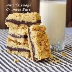 Nutella Fudge Crumble Bars - buttery crunchy oatmeal crumble bars with a smooth creamy Nutella fudge filling. You will make these again and again.
