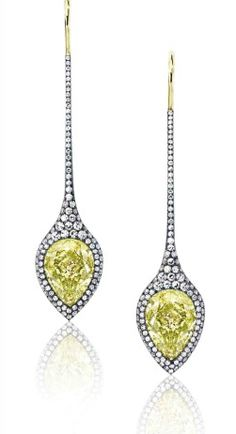 Arrow earrings with central pear-shaped fancy yellow diamonds of a total of 14.57 carats in 18k yellow gold, platinum and steel from Sotheby's Diamonds http://www.sothebys.com/content/dam/sothebys/PDFs/Flippable/sothebys_diamond/index.html#/24/