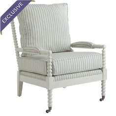 A timeless addition to your living room or den, this turned beech wood arm chair showcases castered feet and striped upholstery.    Prod...
