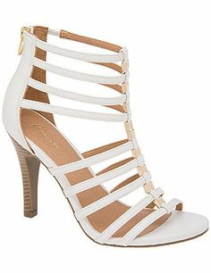 With a sexy, strappy front and hardware detailing, our caged heeled sandal amps up the attitude on sunny days and sultry nights. A fierce, fashionable finish to everything from jeans to formal dresses, this sexy sandal elevates your look with a stiletto heel and zip-up back. In wide widths for all day comfort, with stretchy straps for easy-wearing give. lanebryant.com