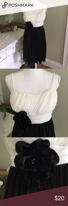 """City Studio Black and White Prom Formal Dress This black and white formal dress is perfect for weddings, dance and events and features an empire waist, spaghetti straps, sash and black flower accent. Size: Medium. Chest: 16"""". Waist: 14"""". Length: 34.5"""" #0156 City Studio Dresses Midi"""