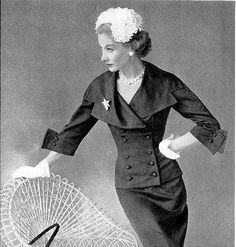 Lisa Fonssagrives is wearing a suit by Jacques Fath, Vogue, March 1951