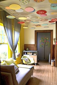 embroidery hoops and fun fabric make for an interesting ceiling| Offbeat Home