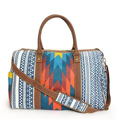 This large size duffle will put any suitcase to shame with its ample storage space along with Baja inspired mixed woven and canvas tribal print exterior with contrast handles and crossbody strap.