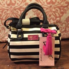 """Betsey Johnson Mini Barrel Crossbody Brand new with tags~ This adorable Betsey Johnson purse features a cute faux leather bow, with tassel. Perfect for an occasion.  Features: Double handles with 3"""" drop; detachable, adjustable 22"""" strap.  Zipper closure and gold tone hardware.  Exterior has a zipper pocket, lining is black and white stripped fabric.  7 1/2"""" W x 5 3/4"""" H x 3 1/2"""" D Betsey Johnson Bags Crossbody Bags"""
