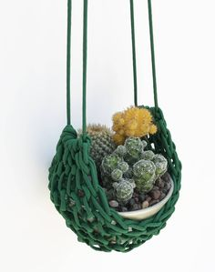Succulent Plant Holder, Modern Macrame Wall Hanging, Plant Hangers, Vertical Plant Hanger, Garden Accessories, Outdoor Accessories, Boho by knitknotsupplyco on Etsy https://www.etsy.com/listing/542764141/succulent-plant-holder-modern-macrame