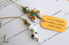 White and pistachio green cloisonné beaded bookmark with butterfly bead on gold thread with Bahai quotation on gold card, Page book holder by elikamahony on Etsy