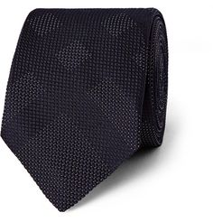 Add visual interest to formal looks with Burberry London's silk-jacquard tie. Woven from navy and white yarns into a cool pin-dot and checked pattern, this slim design is left unlined for a casual drape. It will look especially dapper against narrow lapels.