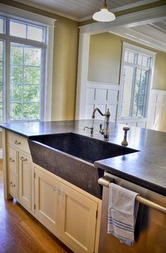 Hmmmm crazy idea. What if we put the sink in the island and let the original window in the kitchen stay tall and not blocked?