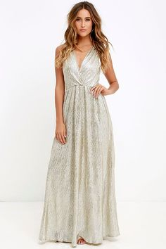 With its glimmering silver-meets-gold fabric, the All that Shimmers is Gold Light Gold Maxi Dress will have you shining like a real starlet! Sultry surplice bodice forms a deep V in front and back, while gathered fabric at the shoulders makes this sleeveless dress really shine! Elasticized waist and maxi length form a feminine shape.