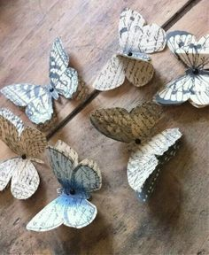 Paper butterflies made from old books. Love this, but not sure I could bring myself to cut up old books - maybe newspaper instead? And use as a shoe embellishment maybe? Paper Butterflies, Butterfly Art, Paper Flowers, Butterfly Ornaments, Book Page Crafts, Arts And Crafts, Diy Crafts, Old Books, Diy Paper