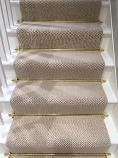 Client: Private Residence In West London Brief: To supply & install grey carpet with brass stair rods to the stairs