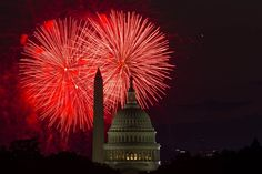 Fireworks illuminate the sky over the U.S. Capitol building and the Washington Monument during Fourth of July celebrations, on July 4, 2014, in Washington, DC