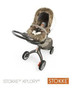 209 euros Stokke® Xplory™ Sheepskin Ignore this BS and DIY. Ikea sheepskin make two cuts so the straps fit around it. DONE.