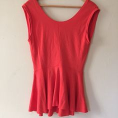 Pretty Zara Coral Peplum Top Round neck in front and a deeper v in back distinguish this structured peplum top by Zara. Wear it to work and for happy hour. Perfect to add a pop of color to any outfit. No trades. Offers welcome. Take 30% off your entire purchase automatically at checkout when you use the bundle feature. I am also happy to create a special bundle for you. Happy Poshing!  Zara Tops