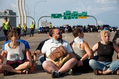 Traffic resumed at about 9:15 a.m. on southbound I-35W at University Avenue after protesters lined up across the highway bridge near downtown to protest police shootings. Authorities arrested 41 people.