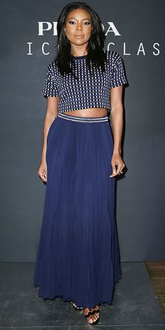 in a crop top outfit with embellished waistline, Loeffler Randall sandals and black satin clutch at the Prada: The ...
