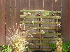 pallets....what if it had boots for plant holders in  them... Too much?