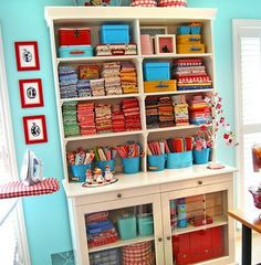 A HUTCH FOR FABRIC STORAGE. I LIKE THIS IDEA. THE BRIGHT COLORS OF YOUR FABRIC WOULD BRIGHTEN THE ROOM UP.