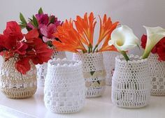 Recycled bottles covered in crochet and adorned with Spring-ness from my garden! Read about my appeal for jars here - freshlyfound.blogspot.com/2010/09/pbjs-please.html
