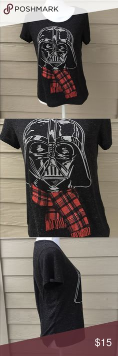 Star Wars Winter Shirt Who's ready for the new Star Wars movie coming out?! I know I am! This shirt is PERFECT to sport the up coming movie during the fall and winter months. Shirt has been gently used, no stains or tears. Shirt shows Darth Vader wearing a scarf. This shirt is just too cute to pass up during the season change 😍🍂❄️🌌✨Shirt is a woman's medium. Can fit small and be slightly baggy, shirt still has stretch that it could fit large and be slightly tight Star Wars Tops Tees…