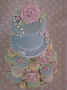 This creation was inspired by Cath Kidston, decorated in pastal shades and adorned with roses, pearls, bows & bunting. www.facebook.com/sugarsweetcakes