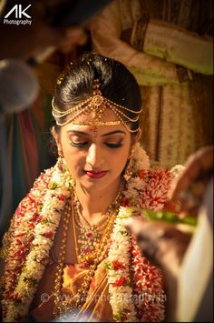 South Indian brides are defined by their allegiance to tradition....beauty with minimal jewelery...and garlands woowww...