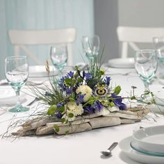 www.alfabridal.com Lovely centerpiece....So different, striking!!