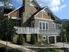"""Nice side profile of new craftsman construction.  I like the garage on the bottom level. I like the broad chimney.    The Sunnyside at The Village of Cheshire in Black Mountain, NC.  This plan is 2,765 Heated Square Feet, 3 Bedrooms and 3 1/2 Bathrooms. The master bedroom is on the main floor. The dimensions are 45'-0"""" x 68'-9"""". NC0041"""
