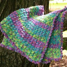 The variegated colors in this blanket are beautiful and bright. This Jungle Rhythm Baby Blanket by Amy Molloy seems to be so much fun. If you wonder what brand and colors are used in this happy and soft to touch baby blanket, here is the answer:  Red Heart's Gumdrop in colors Smoothie, Grape, and Apple. …