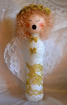 Wine Bottle Angel DIY Christmas Decoration | A stunning angel craft made with a wine bottle, paint, and lace. Heavenly!