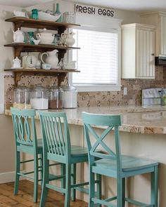 The #decorenthusiast want to see our wall shelves....I will use any excuse to share my open shelves my husband built a few weeks ago!! Removing the old cabinet and replacing it with open shelves really opened up this area of my kitchen plus it gave me more space to display my collected dishes!! #kitchen #startathome my barstools are painted with Quarry by Pratt and Lambert