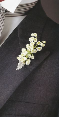 Lily of the Valley Bouttoniere in an antique sterling silver vase (keeps your delicate flower fresh). Classic wedding boutonnieres are lilies of the valley, a carnation, or one to two little spray roses (small rose buds)
