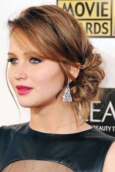The messy side bun look on Jennifer Lawrence. on The Fashion Time http://thefashiontime.com/16-simple-elegant-hairstyles-next-big-event/#sg1