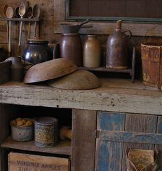 Primitives cubby with old wood bowls & spoons & crocks