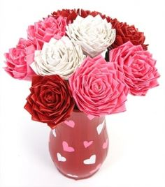 Duck tape roses. I bet these would look great with fabric squares instead of tape!