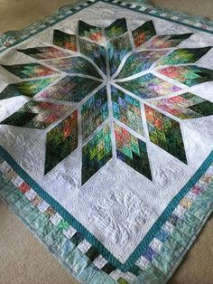 Prismatic Star, Quiltworx.com, Made by Lynn B, Quilted by Joanne N. Like gravity quilt but with sashing. Love the deep green points.