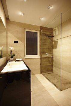 Apartments, Shower Glass Wall White Marble Tile Floor Glass Window Black Wooden Washstand Beige Wall Bathroom Apartment Budapest Kate Koppany: Modern Improvement Offered by contemporary home design magazine