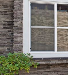 Brand: StoneTransitions® & Cultured Stone®<br />  Product Shown: Rock Faced, WATERTABLE/SILL - In Coal & Black Mountain, PRO-FIT® ALPINE LEDGESTONE