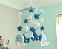 Welcome To Flossytots This beautiful Elephant mobile is READY TO SHIP This mobile consists of 2 Corn Flower Blue elephants and 2 White elephants with Blue polka dot fabric on the ears, made with premium wool blend felt. Above each elephant are 2 stars. Hanging in the centre are 3 clouds. The hoop is decorated in a polka dot fabric. These mobiles are original Flossytots designs and are carefully cut and handstitched with lots of care and attention to detail. They make a beautiful feature f...