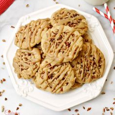 Southern praline candy combines a brown sugar cookie that's both crisp and chewy, with a topping of pecans and a generous drizzle of praline icing.