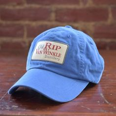This light blue ball cap features a classic Old Rip Van Winkle Distillery  patch 209288500a59